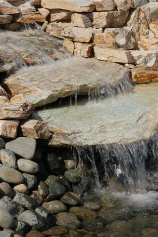 The waterfall in the lower pond at Hillside Stone & Garden yard